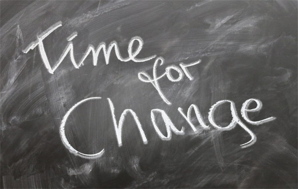 """Black board reads """"Time for Change"""""""