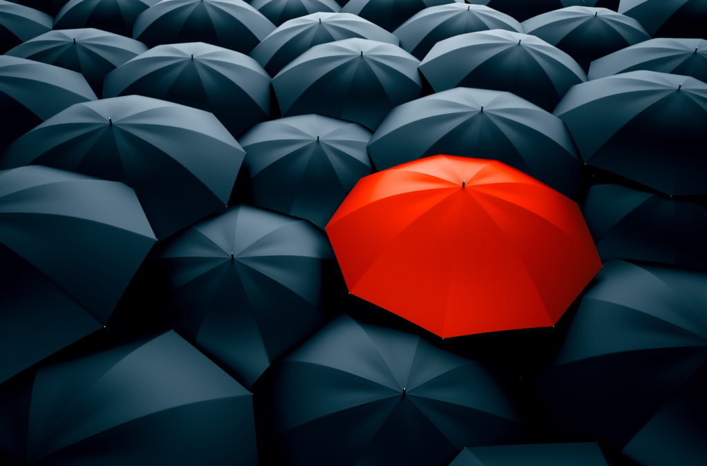 Different, unique and standing out of the crowd red umbrella. 3D Illustration