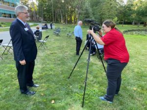 Aquinas College President Quinn doing a media interview with WZZM 13